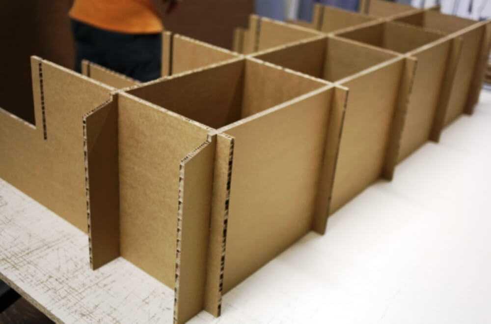гофрированный картон применяется для хранения не только в виде коробок но и в виде полок и ячеек